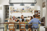 Three generation family eating in the kitchen at home - 211902760