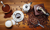 Traditional espresso cup with mocha, coffee beans, ground coffee, sugar, scoop and grinder. Top view - 211911329