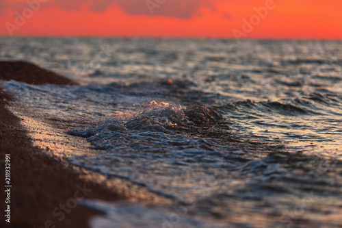 Beautiful warm light over the sea after sunset - 211932991
