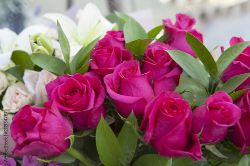bouquet of pink roses in a vase given for a birthday