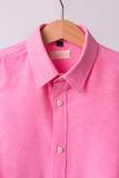 hanging pink shrits on white background, Hanger. - 211941989
