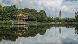 The Three Pagodas of the Chongsheng Temple and a traditional Chinese pavilion, with their reflections in a pond, near Dali, Yunnan, China - 211948568