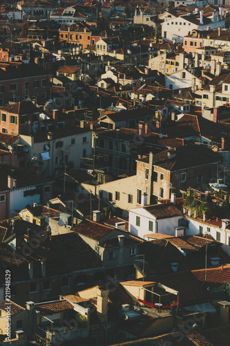 Venetian houses and rooftops of Venice, Italy during sunset - 211948529