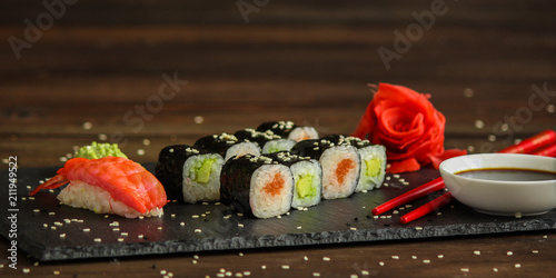 Fotobehang Sushi bar sushi rolls Fresh and delicious (portion of sushi) - Sushi menu. Japanese food. food background
