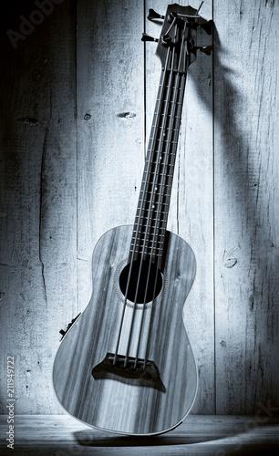 ukulele bass on wooden background - 211949722