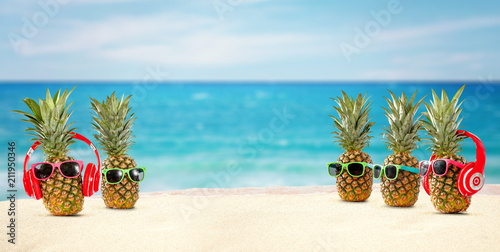 Leinwanddruck Bild fresh pineapple on beach