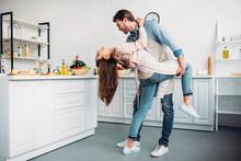"""Постер, картина, фотообои """"couple dancing tango together in kitchen"""""""
