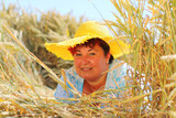 Overweight woman enjoying life during summer vacations. Happy obese farmer relaxing on wheat field. Healthy lifestyle concept. - 211976122