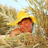 Overweight woman enjoying life during summer vacations. Happy obese farmer relaxing on wheat field. Healthy lifestyle concept. - 211976163