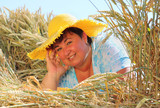 Overweight woman enjoying life during summer vacations. Happy obese farmer relaxing on wheat field. Healthy lifestyle concept. - 211976195