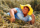 Overweight woman enjoying life during summer vacations. Happy obese farmer relaxing on wheat field. Healthy lifestyle concept. - 211976346