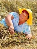 Overweight woman enjoying life during summer vacations. Happy obese farmer relaxing on wheat field. Healthy lifestyle concept. - 211976390