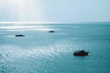 Boats on shiny sea - 211977122