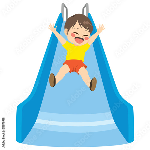 Cute little child boy playing on blue slide at playground - 211979919