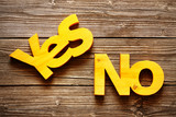 Wood yellow words yes and no on a wooden texture background - 211985992