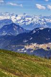 Traveler trekking on Rigi kulm with landscape view of Alps snow mountain and pine tree , Luzern Switzerland