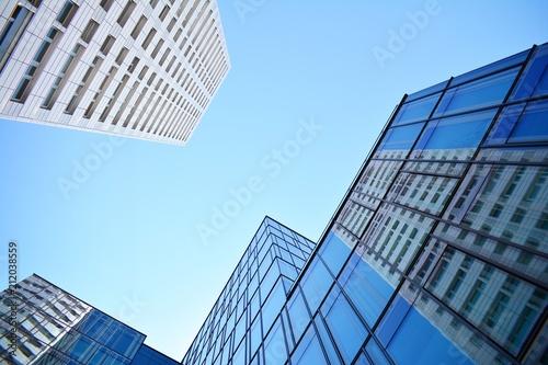 Foto Murales Blue clean glass wall of modern skyscraper
