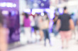 People waiting up a queue at ATM in department store, Blurred background - 212041978
