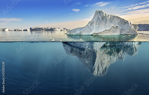 iceberg with above and underwater view