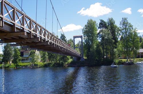 Fototapeta A wooden cycling bridge in Vansbro,Dalarna