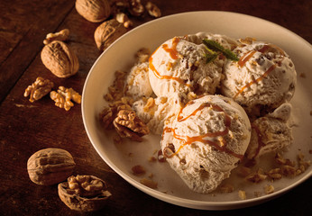 Maple Walnut Ice Cream with Caramel Sauce in Bowl © exclusive-design