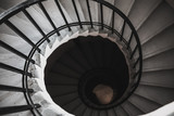 View to the circle spiral staircase in old building, black and white - 212063751