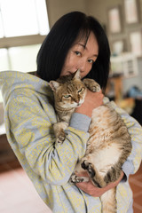 woman hold cat