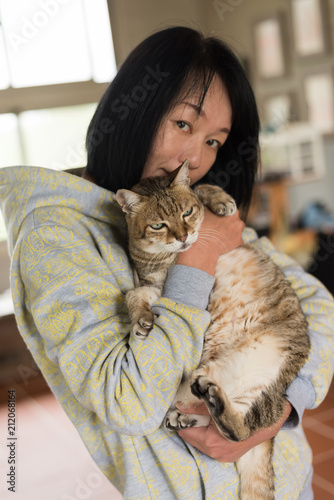 Fototapeta woman hold cat