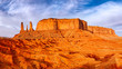 Leinwanddruck Bild - Monument valley landscape view with rock formations and textured foreground