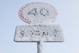 Frosted speed limit road sign in winter - 212077338