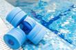 Leinwanddruck Bild - dumbbells equipment for aqua aerobics sport near swimming pool