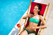Leinwanddruck Bild - Woman enjoying cocktail at pool