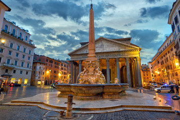 The Pantheon with fountain and obelisk at dusk in Rome, Italy