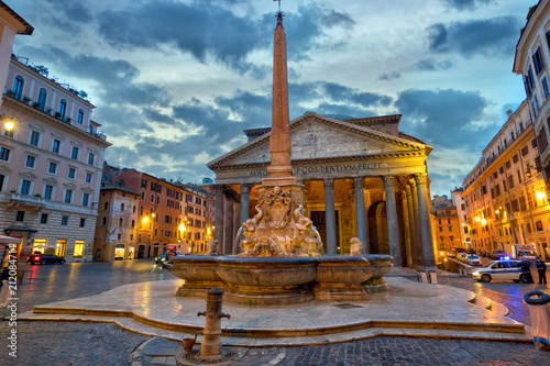 The Pantheon with fountain and obelisk at dusk in Rome, Italy - 212084714