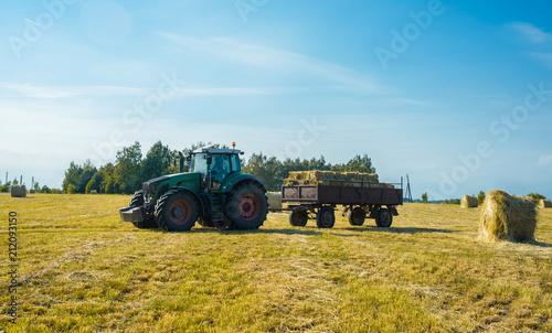 Aluminium Trekker tractor on the field with hay