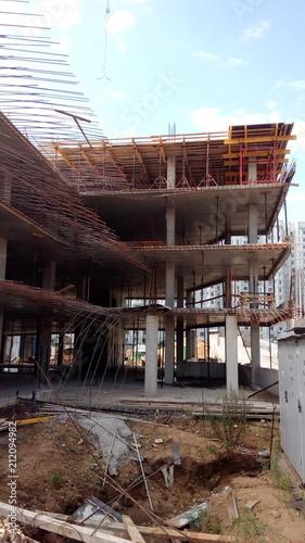 Fotobehang Oude verlaten gebouwen Construction of a multi-apartment residential building. The process of construction. Stages of construction.