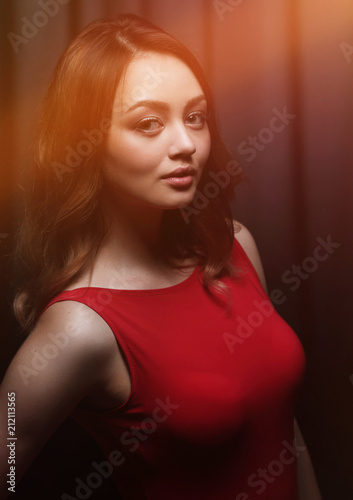 Fashionable young beautiful woman in a red dress