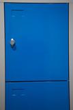 a blue metal locker with closed door - 212132938