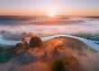 Summer aerial landscape. Sunrise over fog and river.