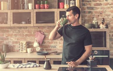 handsome man drinking Turkish coffee