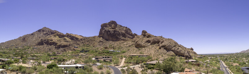 This is a 4 image aerial panoramic of iconic Camelback Mountain in Phoenix, Arizona, USA
