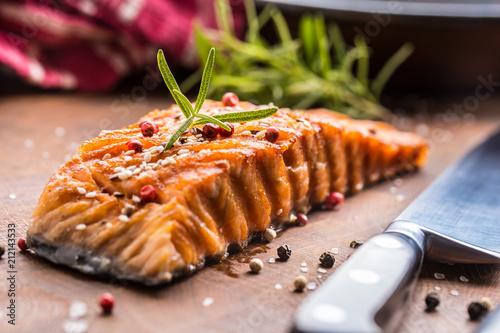Fotobehang Steakhouse Salmon fillet grilled with salt pepper sesame and herb rosemary
