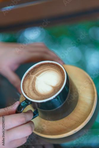Hand Holding Hot Coffee
