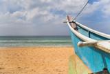 Image of boat at the beach in Sri Lanka.