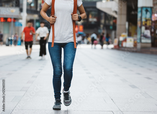 Fototapeta young woman walking in modern city