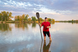 Male paddler with a long stand up paddle - 212165133
