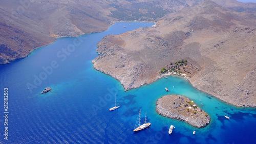 Plexiglas Lavendel Aerial birds eye view photo taken by drone of famous tropical rocky beach of Agia Marina, Symi island, Dodecanese, Greece