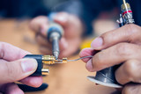 Closeup of soldering RCA cable, Repair and adjustment of the equipment, the RCA cable and pliers on the table - 212192371