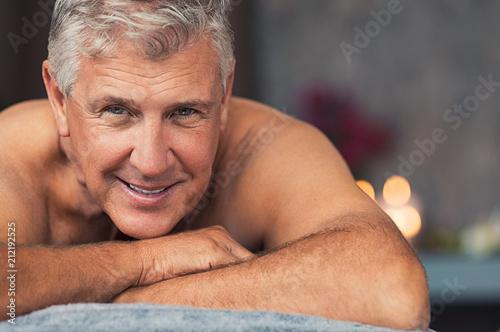 Leinwanddruck Bild - Rido : Smiling senior man at spa