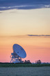 Colorful sunset sky over radiotelescope antenna at astronomy observatory, Piwnice, Torun, Poland